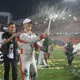 Michael Schumacher et Sebastian Vettel lors de leur victoire sur l'épreuve de la Nations Cup durant la Race of Champions à Bangkok le 15 décembre 2012