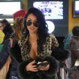 Nabilla à l'aéroport à Roissy Charles de Gaulle le 14 janvier 2013 pour participer à la saison 5 des Anges de la télé-réalite à Miami.