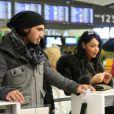 Nabilla et Thomas à l'aéroport à Roissy Charles de Gaulle le 14 janvier 2013 pour participer à la saison 5 des Anges de la télé-réalite à Miami.