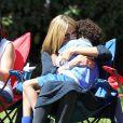 Heidi Klum a accompagné ses enfants Leni, Henry, Johan et Lou a un match de football avec son compagnon Martin Kristen à Brentwood. Le 9 mars 2013. Maman poule elle n'hésite pas à faire des câlins à son fiston.