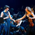 Nolwenn Leroy au côté d'Anne Gravoin, femme de Manuel Valls, en concert avec l'Orchestre symphonique de Vladimir Cosma au Grand Rex à Paris, le 23 mars 2013.