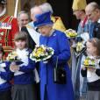 La reine Elizabeth II, accompagnée de son époux le duc d'Edimbourg, prenait part le 28 mars 2013 à la messe de célébration du Jeudi saint donnée à la cathédrale d'Oxford.
