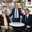 """Charles Aznavour, Jacques Pessis et Georges El Assidi - Vernissage de l'exposition """"Trenet : Le Fou chantant de Narbonne à Paris"""" à la Galerie des Bibliothèques à Paris, le 11 avril 2013."""