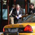 Gérard Depardieu est en train de lire le scenario du film sur DSK d'Abel Ferrara en sortant de son hôtel à New York le 14 avril 2013