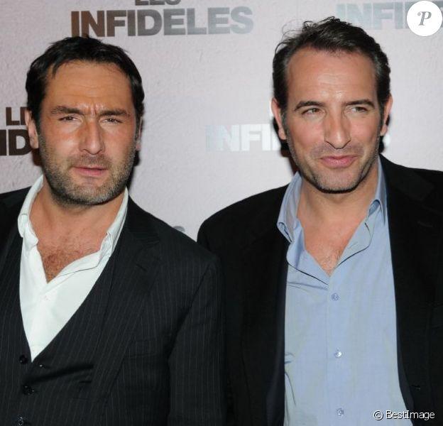 Gilles Lellouche et Jean Dujardin lors de l'avant-première des Infidèles à Paris le 14 février 2012.