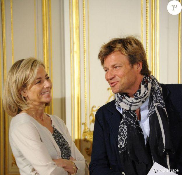 Claire Chazal et son complice d'un jour Laurent Delahousse à la conférence de presse de l'opération La Flamme Marie Claire à l'hôtel le Marois à Paris, le 16 mai 2013.