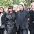 Brigitte Fontaine et Areski Belkacem - Obsèques de Georges Moustaki au Père-Lachaise à Paris. Le 27 mai 2013.