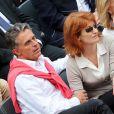 Gerard Holtz et son épouse Muriel Mayette lors de Roland-Garros le 1er juin 2013.