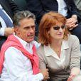 Gerard Holtz et sa femme Muriel Mayette dans les tribunes de Roland-Garros le 1er juin 2013.