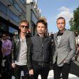 Le groupe avec Muse Matt Bellamy en son centre, Christopher Wolstenholme à droite et Dominic Howard à gauche, lors de la première mondiale de World War Z, à l'Empire Leicester Square, Londres, le 2 juin 2013.