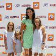 Angie Harmon et ses trois filles au 7e Kidstock Music and Art Festival au manoir Greystone à Beverly Hills, le 2 juin 2013
