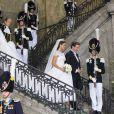Mariage de la princesse Madeleine de Suède, vêtue d'une robe signée Valentino, et Chris O'Neill, le 7 juin 2013 à Stockholm. Après la cérémonie dans la chapelle du palais royal, les jeunes mariés ont emprunté une calèche pour se rendre à Riddarholmen et embarquer pour Drottningholm, résidence royale où se tenait la réception.