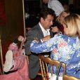 """Christophe Beaugranddéguisé en cochon, Laurent Gerra et sa compagne Christellelors dela soirée """"La charcuterie fait son show"""" au Chalet du Lac à Paris le 10 juin 2013."""