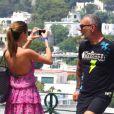 Christian Audigier et sa jolie fiancée Nathalie Sorensen heureux lors d'un week-end romantique à Capri en Italie, le 21 juin 2013.