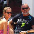 Le créateur français Christian Audigier et sa fiancée Nathalie Sorensen heureux lors d'un week-end romantique à Capri en Italie, le 21 juin 2013.