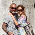 Christian Audigier de retour dans sa ville natale d'Avignon où il a joué les touristes en compagnie de sa belle Nathalie Sorensen devant le pont d'Avignon le 17 juin 2013