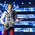 Matthew Bellamy en concert avec son groupe Muse au Stade de France le 21 juin 2013.