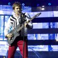 Matthew Bellamy en concert avec son groupe Muse au Stade de France le 21 juin 2013.