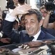 Nicolas Sarkozy quitte le siège parisien de l'UMP après la réunion extraordinaire du bureau. Le 8 juillet 2013.