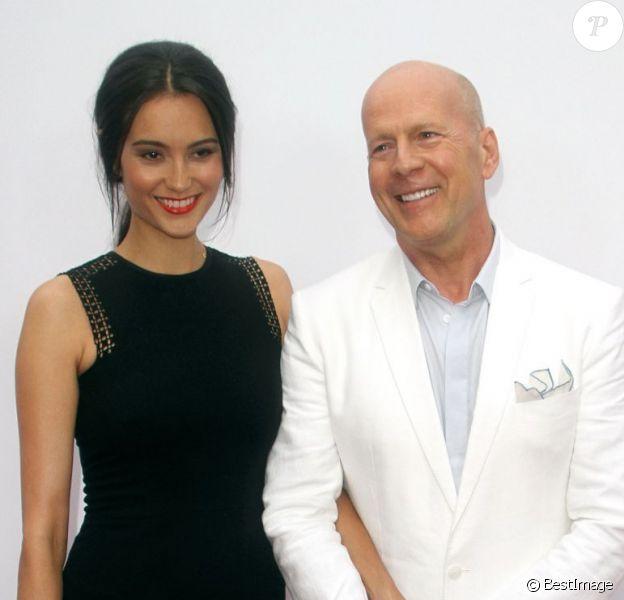 Bruce Willis et sa femme Emma Heming lors de l'avant-première du film Red 2 à Los Angeles le 11 juillet 2013