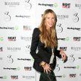 """Elle Macpherson arrive à la soirée """"Dog Jogger"""" à Londres, le 26 mars 2013."""