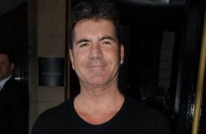 Simon Cowell : Il bronze loin du divorce de la femme enceinte et du mari trompé