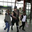 Madonna et ses enfants David, Mercy et Lourdes à l'aéroport de Londres. Le 3 septembre 2013.