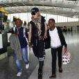 Madonna, accompagnée de David, Mercy et Lourdes à l'aéroport de Londres. Le 3 septembre 2013. La chanteuse s'envole certainement pour New york où elle possède sa résidence principale.