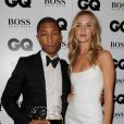 Pharrell Williams et Rosie Huntington-Whiteley sur le tapis rouge des  GQ Men of the Year Awards  à Londres, le 3 septembre 2013.