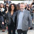 Virginie Silla et Luc Besson lors du défilé Dior à Paris le 28 septembre 2013