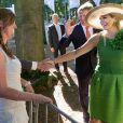 La reine Maxima et le roi Willem-Alexander des Pays-Bas lors de l'inauguration de l'exposition tirée du Droomboek au palais Het Loo le 5 septembre 2013.