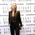 Kate Moss assiste à l'ouverture de la boutique Stuart Weitzman à Milan, le 19 septembre 2013.