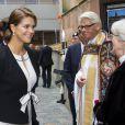 La princesse Madeleine le 17 septembre 2013 à Stockholm lors des cérémonies pour l'inauguration du Parlement, auquel elle a pris part, enceinte, avec la famille royale et son époux Chris O'Neill.
