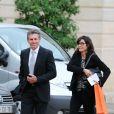 Claude Puel et sa femme lors de la remise des insignes de la Légion d'honneur et de l'Ordre national du Mérite par François Hollande au Palais de l'Elysée le 9 octobre 2013