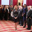 Virginie Coupérie-Eiffel lors de la remise des insignes de la Légion d'honneur et de l'Ordre national du Mérite par François Hollande au Palais de l'Elysée le 9 octobre 2013