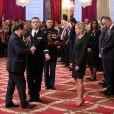 François Hollande et Cécile Nowak-Grasso lors de la remise des insignes de la Légion d'honneur et de l'Ordre national du Mérite par François Hollande au Palais de l'Elysée le 9 octobre 2013