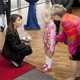 La princesse Marie de Danemark, représentant l'Université Syddansk, à l'Université de Flensburg le 11 octobre 2013 pour une cérémonie de remise de diplômes.