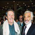 Jean Rochefort et Jean-Paul Belmondo lors d'une exposition le 11 novembre 1999
