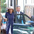 Carole et Michael Middleton dans Chelsea, en route pour le baptême de leur petit-fils le prince George de Cambridge, le 23 octobre 2013.