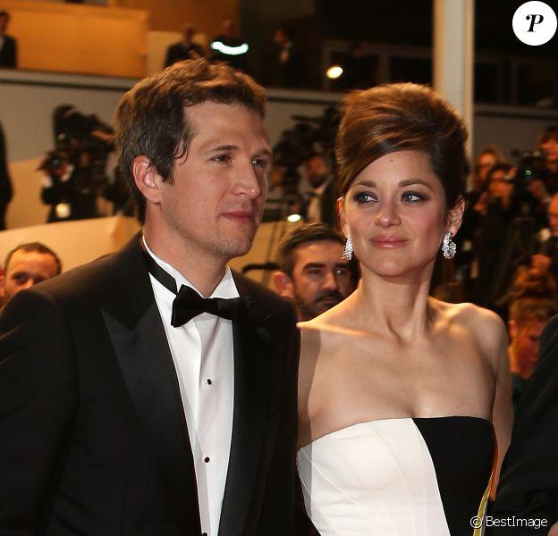 Guillaume Canet et Marion Cotillard sur le marches du palais des festivals à Cannes le 20 mai 2013