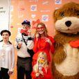 Natalia Vodianova, enceinte, présente au coté de l'animatrice Tutta Larsen et de l'artiste Andrei Bartenev, son projet caritatif Give a Smile au Garage Centre for Contemporary Culture. Moscou, le 20 novembre 2013.