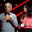 Yamina Benguigui remettait à Gilberto Gil le Grand Prix des Musiques du monde lors de la cérémonie des Grands Prix Sacem 2013, le 25 novembre 2013 à l'Olympia de Paris.