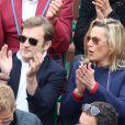 Laurence Ferrari et son mari Renaud Capuçon dans les tribunes du tournoi de Roland-Garros, le 9 juin 2013.