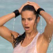 Adriana Lima : Sans soutien-gorge à la plage, elle se la joue t-shirt mouillé