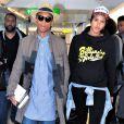 Pharrell Williams et Helen Lasichanh à l'aéroport d'Heathrow à Londres, le 4 septembre 2013.