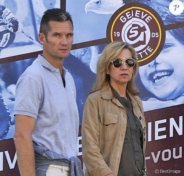 Cristina d'Espagne avec son mari Iñaki Urdangarin à Genève le 3 septembre 2013. Le 6 janvier 2014, la fille cadette du roi a été mise en examen dans l'affaire Noos, deux ans après l'inculpation de son époux.