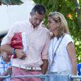 Cristina d'Espagne avec son mari Iñaki Urdangarin à Genève le 30 août 2013. Le 6 janvier 2014, la fille cadette du roi a été mise en examen dans l'affaire Noos, deux ans après l'inculpation de son époux.