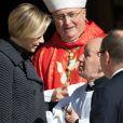 Charlene et Albert de Monaco au sortir de la messe pontificale de la Sainte Dévote, le 27 janvier 2014 en principauté.
