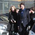 Natalia Viodanova enceinte et son compagnon au défilé Louis Vuitton à Paris, le 5 mars 2014.