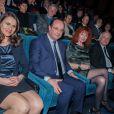 Aurélie Filippetti, François Hollande, Sabine Azéma, Jean-Marc Ayrault et sa femme Brigitte lors de l'hommage à Alain Resnais à l'avant première de son film Aimer, boire et chanter à Paris le 10 mars 2014.